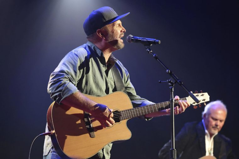 """Garth Brooks, Kent Blazy. From left, artists and songwriters Garth Brooks and Kent Blazy perform """"If Tomorrow Never Comes"""" at the Nashville Songwriters Association International """"50 Years of Songs"""" at the Ryman Auditorium on in Nashville, Tenn"""