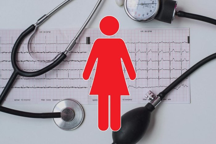stethoscope, chart readout, and blood pressure cuff background with woman symbol overlay