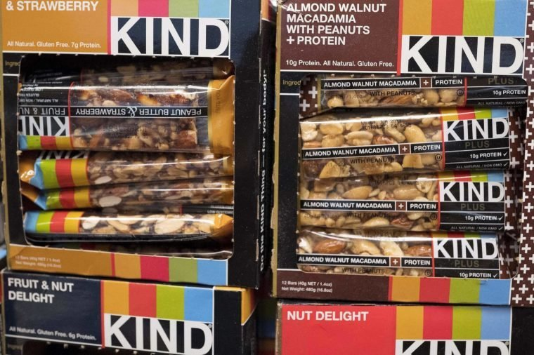 """Kind snack bars are displayed in a New York supermarket, . Kind CEO Daniel Lubetzky is pledging $25 million over the next 10 years to create a nonprofit dedicated to """"revealing and countering"""" the food industry's influence on public health. The move underscores the division between """"Big Food"""" companies and newer players that market themselves as wholesome alternatives aligned with public health"""