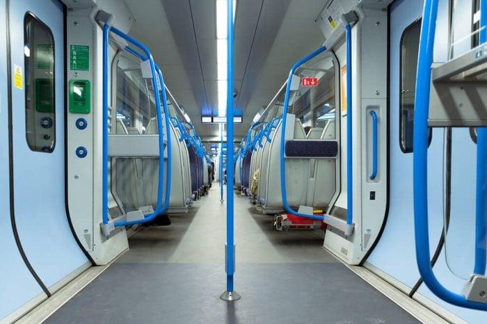 Fast train. London, England. Underground train in London. Seats in subway.