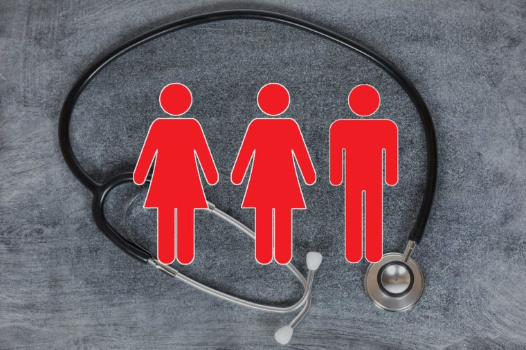 stethoscope on concrete background with woman and man figures overlay