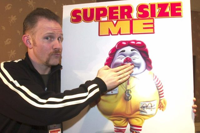 "MORGAN SPURLOCK Morgan Spurlock, director, producer and star of the documentary film ""Super Size Me"" clowns with a movie poster at the U S Comedy Arts Festival, in Aspen, Colo. The documentary, which chronicles the deterioration of Spurlock's health during a monthlong experiment eating nothing but McDonald's food, won a directing prize at the Sundance Film Festival and is set for wide release this spring. McDonalds announced Wednesday that it will Supersize fries and drinks in its more than 13,000 U.S. restaurants and will stop selling them altogether by year's end, except in promotions"