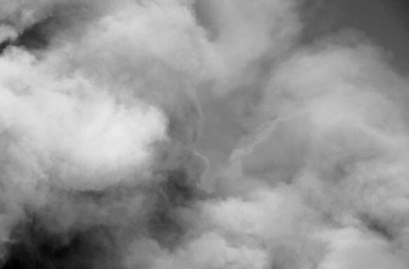 Fluffy Puffs of Smoke and Fog on Black Background.Cloud for use background. Artistic abstraction composed of nebulous.