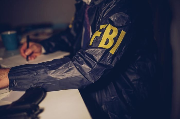 The FBI agent is working at night