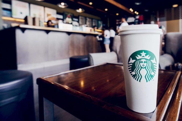 CHIANG RAI, THAILAND- JUNE 23, 2017 : A Venti Starbucks coffee in Starbucks coffee shop.