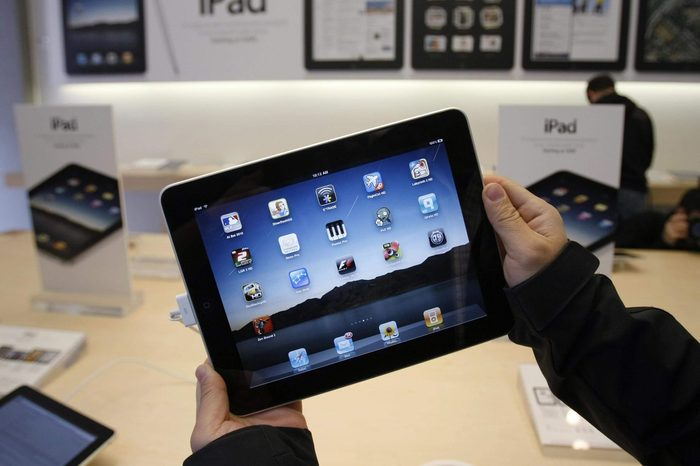Showing customer uses an Apple iPad on the first day of Apple iPad sales at an Apple store in San Francisco. Apple said, it has sold 1 million of its new iPad tablet computers in the month after its launch, meaning it's been selling more than twice as fast as the iPhone did when it was new