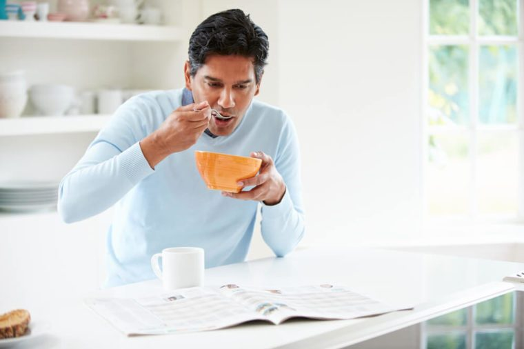 Indian Man Enjoying Breakfast At Home