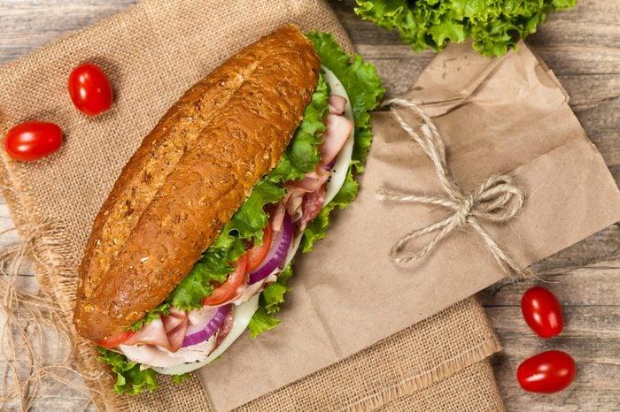 Italian Sub Sandwich with Salami, Tomato, and Lettuce. Selective focus.