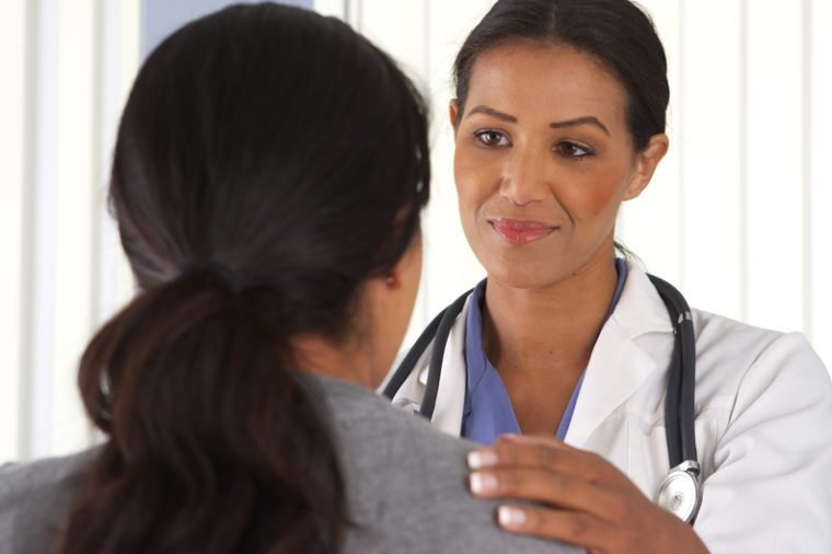 Close up of African American doctor talking to female patient