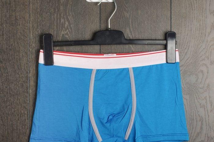 Sexy blue male underwear on the hanger