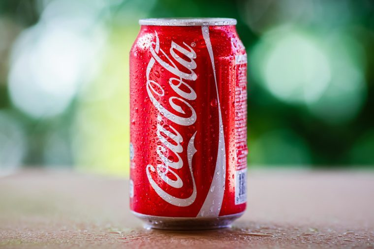 SABAH, MALAYSIA April 10, 2015 : Coca-Cola can with background blurring tree in a park. suitable for decorating supermarkets and restaurants