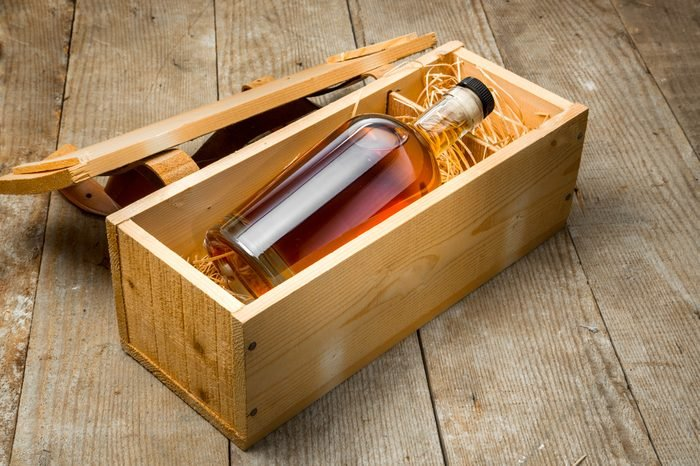 Bottle of liquor aged fine craft whiskey bourbon rum tequila gift package shipping