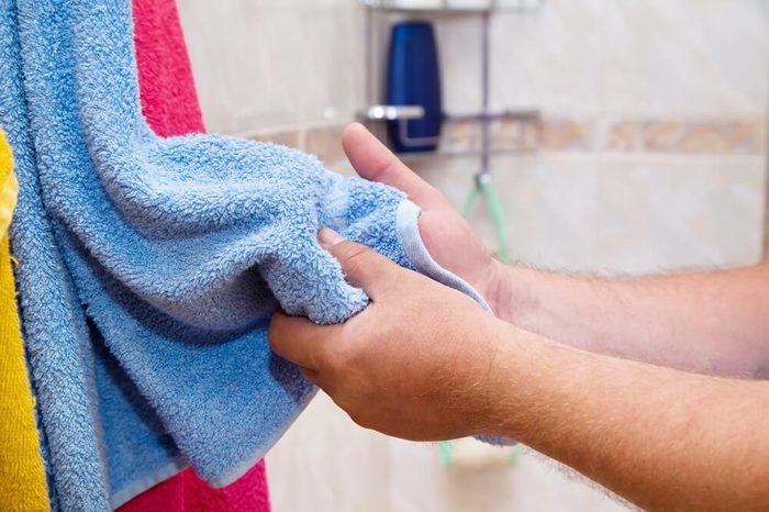 Closeup hands with towel in bathroom