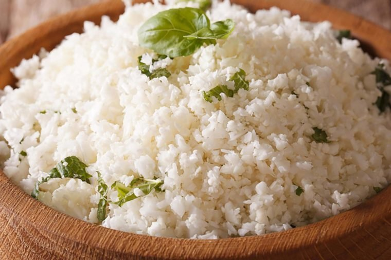 Paleo Food: Cauliflower rice with herbs close-up in the bowl. horizontal