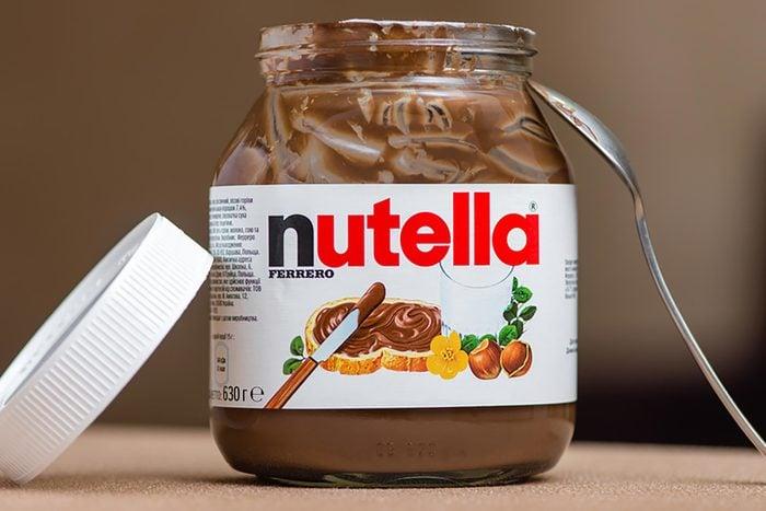 Kyiv, Ukraine - September 27th, 2016: Jar of Nutella Hazelnut on a bokeh background. Nutella is the brand name of a chocolate hazelnut