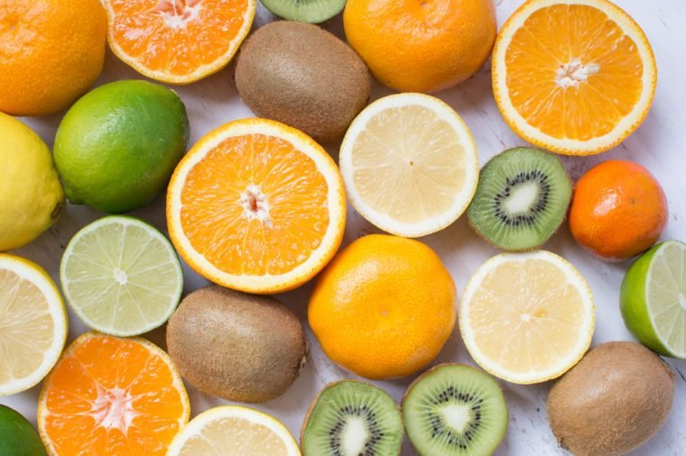 Fruits rich in vitamin C: oranges, lemons, limes, clementines, kiwis, top view, selective focus