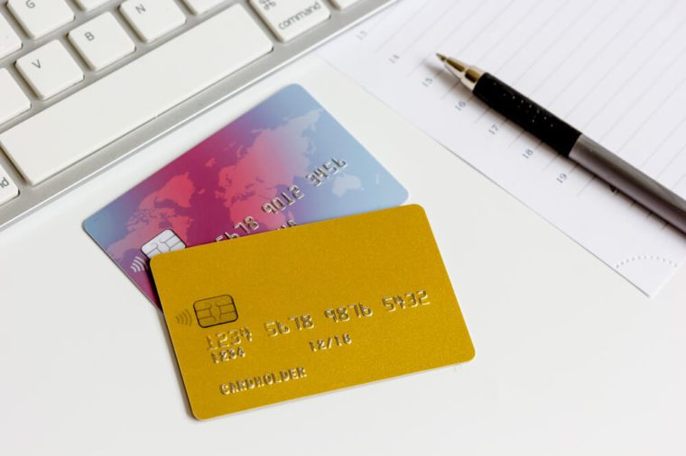 Credit cards with keyboard close up on white background
