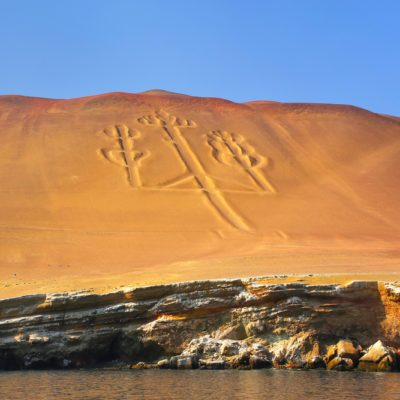 Candelabra of the Andes in Pisco Bay, Peru. Candelabra is a well-known prehistoric geoglyph found on the northern face of the Paracas Peninsula