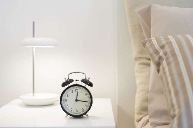 Alarm clock on the nightstad