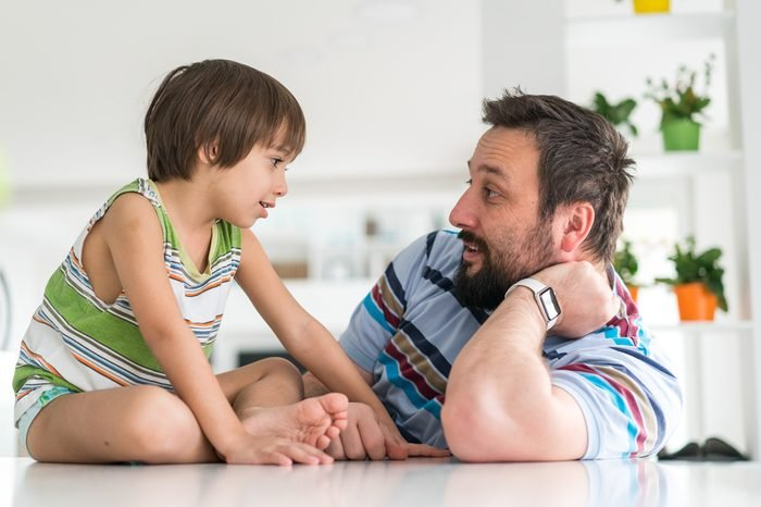 Father and son happy time with little child at home
