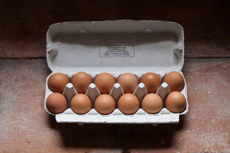 A dozen eggs in an egg cup