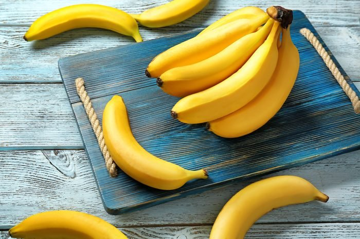 Yummy bananas on wooden background