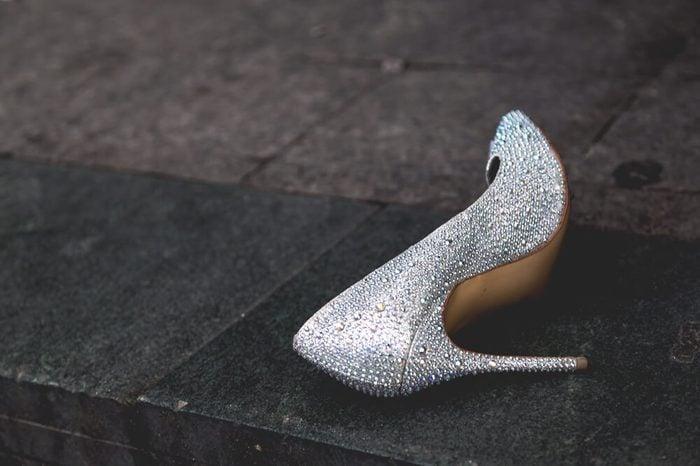 Single bridal shoe left in the street
