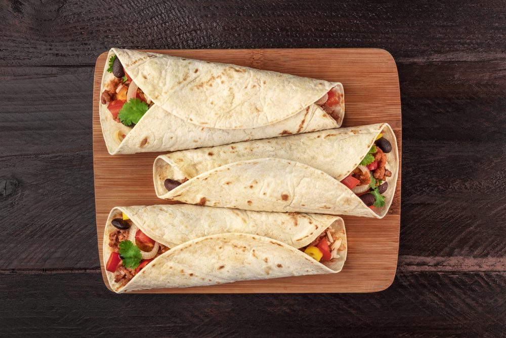 Mexican burritos on a dark background with copy space
