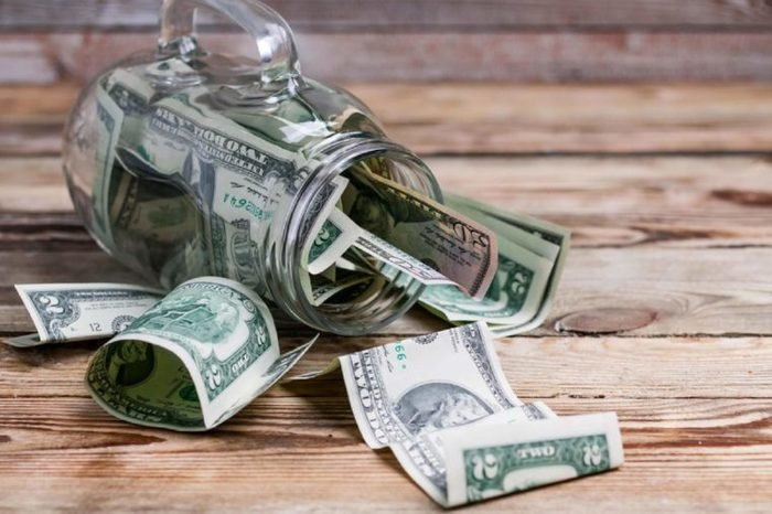 Dollar banknotes in a glass jar. Finance concept.