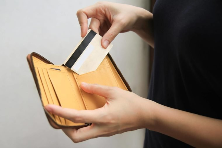 woman hand open leather wallet showing credit card