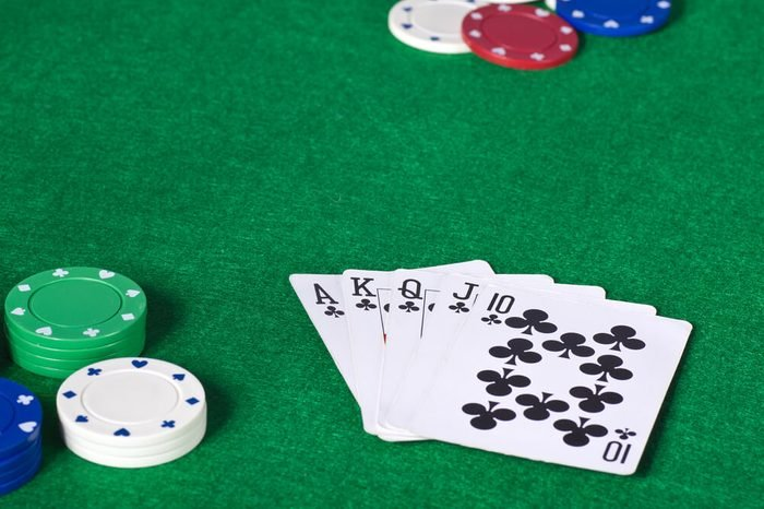 Closeup of cards and chips while playing poker
