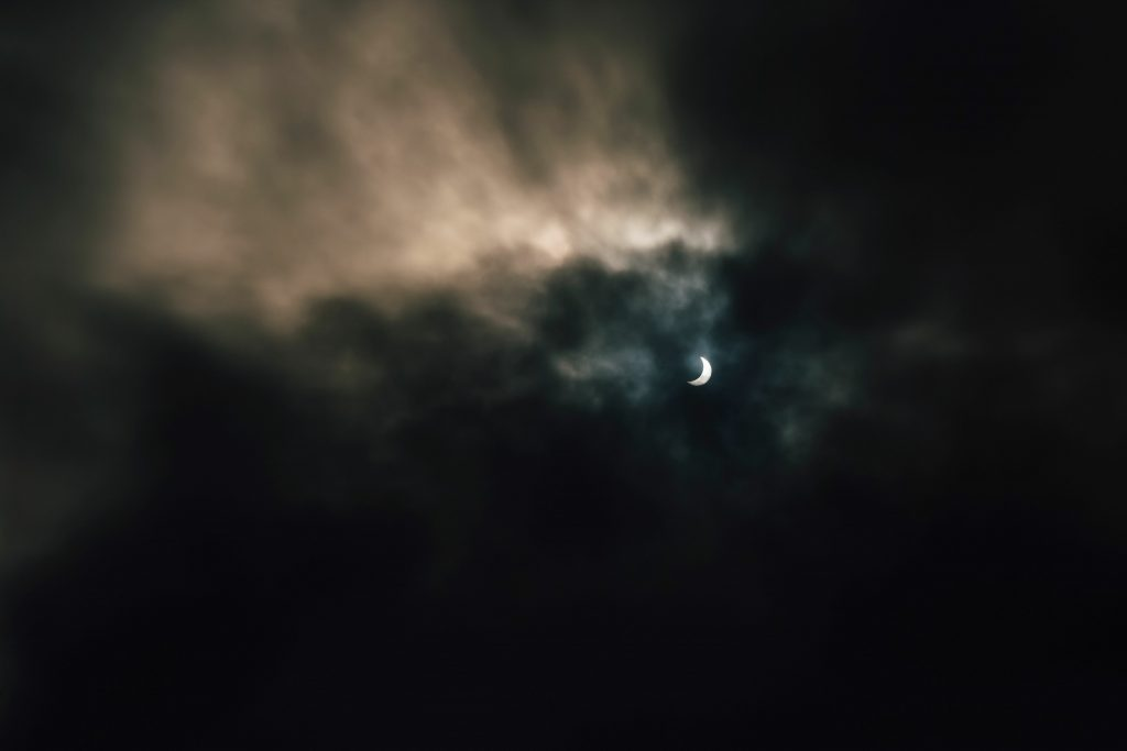 Dark dramatic sky during solar eclipse