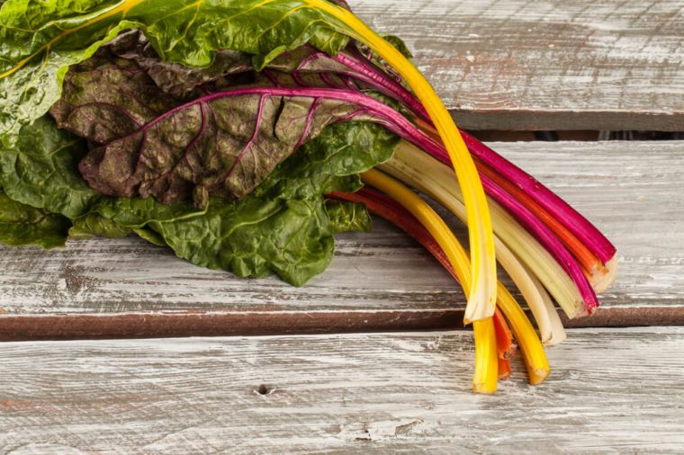 Rainbow Swiss Chard on an old barn wood table