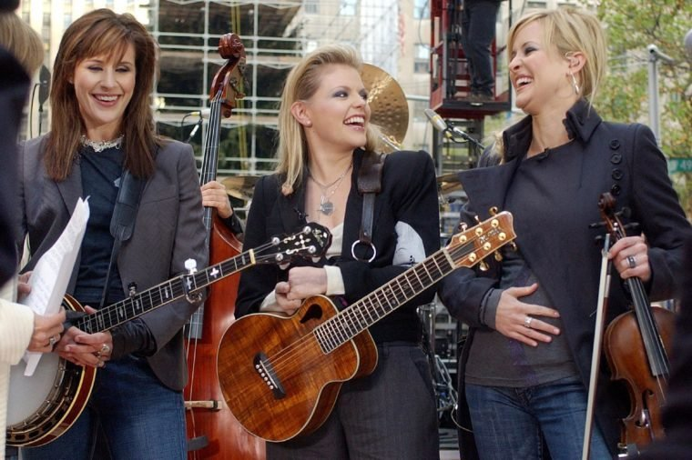 """The Dixie Chicks' Martie Maguire, right, holds her stomach as she was ask about her pregnancy as she appeared with bandmates Emily Robison, left, and Natalie Maines during the NBC """"Today"""" concert series in New York's Rockefeller Plaza, . Maguire's baby is due in May"""