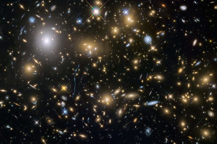 Observations by the NASA/ESA Hubble Space Telescope have taken advantage of gravitational lensing to reveal the largest sample of the faintest and earliest known galaxies in the universe. Some of these galaxies formed just 600 million years after the big bang and are fainter than any other galaxy yet uncovered by Hubble. The team has determined for the first time with some confidence that these small galaxies were vital to creating the universe that we see today. An international team of astronomers, led by Hakim Atek of the Ecole Polytechnique Fédérale de Lausanne, Switzerland, has discovered over 250 tiny galaxies that existed only 600-900 million years after the big bang— one of the largest samples of dwarf galaxies yet to be discovered at these epochs. The light from these galaxies took over 12 billion years to reach the telescope, allowing the astronomers to look back in time when the universe was still very young.
