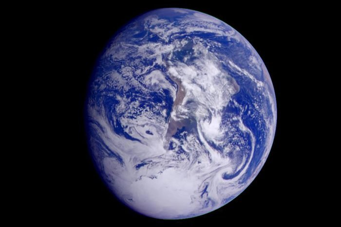 This color image of the Earth was obtained by NASA's Galileo at about 6:10 a.m. Pacific Standard Time on Dec. 11, 1990, when the spacecraft was about 1.3 million miles from the planet during the first of two Earth flybys on its way to Jupiter. The color composite used images taken through the red, green and violet filters. South America is near the center of the picture, and the white, sunlit continent of Antarctica is below. Picturesque weather fronts are visible in the South Atlantic, lower right. This is the first frame of the Galileo Earth spin movie, a 500- frame time-lapse motion picture showing a 25-hour period of Earth's rotation and atmospheric dynamics.