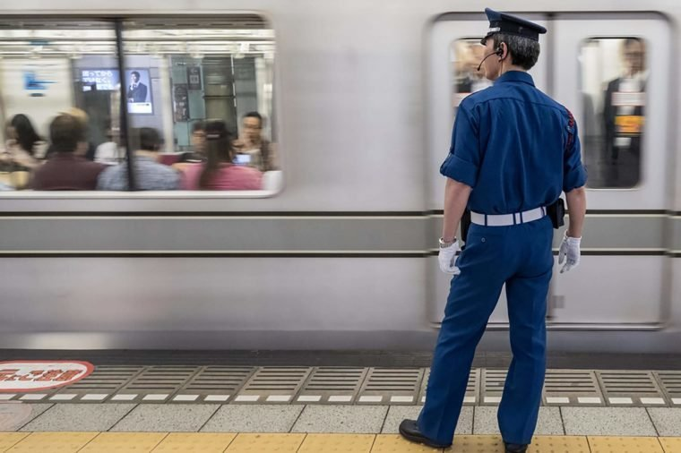 TOKYO, JAPAN - JUNE 2ND 2016. Tokyo Metro subway police standing watch. Tokyo Metro subway is a popular mode of transportation in Tokyo for people to commute.