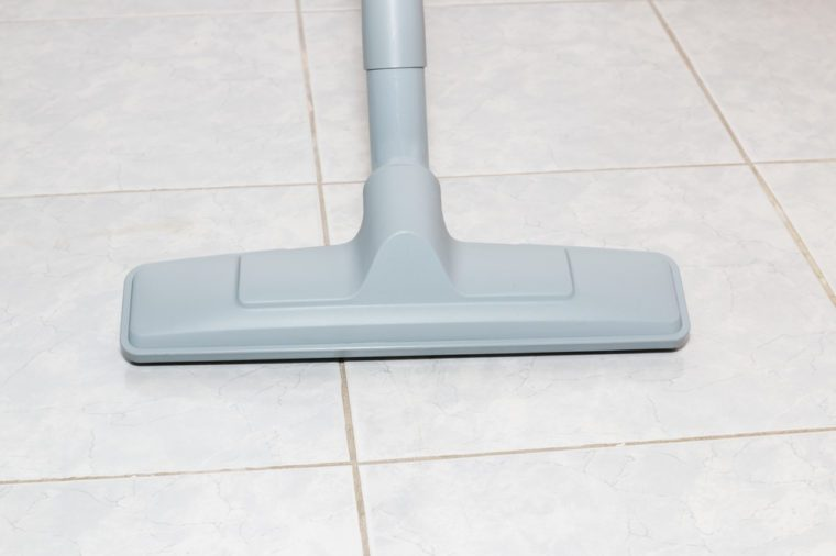 Brush head Vacuum cleaners on tile floors.