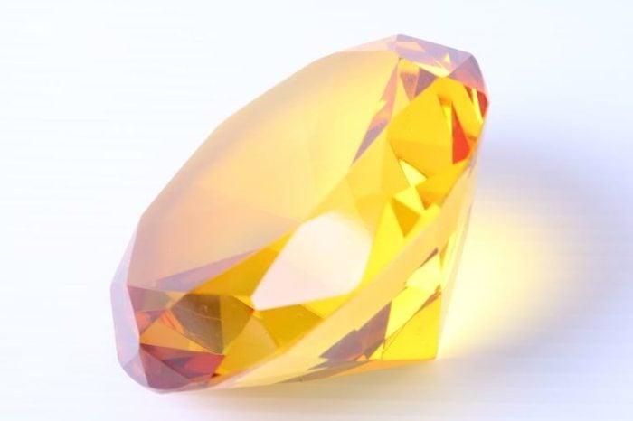 yellow diamond on white surface
