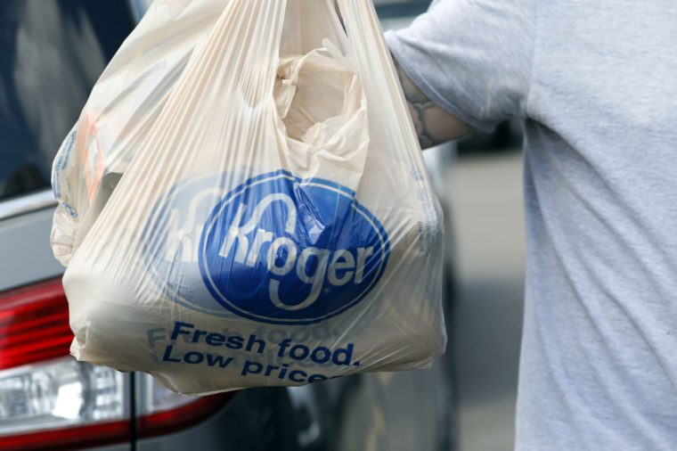 A shopper removes grocery store bags from their shopping cart at a Kroger store in Flowood, Miss. The Kroger Co. reports earnings Thursday, Nov. 30, 2017