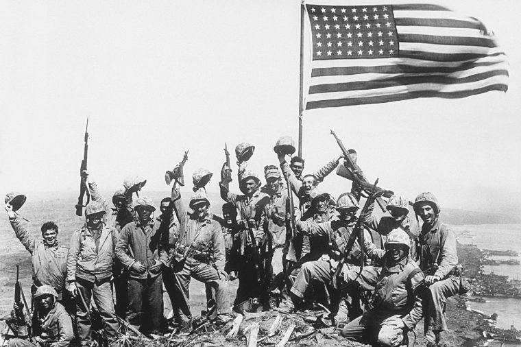 Associated Press International News Japan WWII U.S. MARINES FLAG IWO JIMA U.S. Marines of the 28th Regiment, fifth division, cheer and hold up their rifles after raising the American flag atop Mount Suribachi on Iwo Jima, a volcanic Japanese island, on during World War II