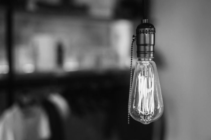 Vintage light bulb on coffee shop background