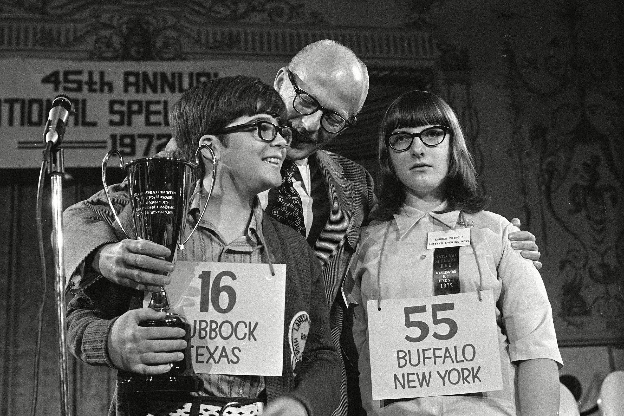 SPELLING BEE Robin Kral, 14, of Lubbock, Texas, left, holds his trophy after winning the 1972 National Spelling Bee in Washington. He out-spelled Lauren Pringle, 13, right, of Buffalo, N.Y., to win the title
