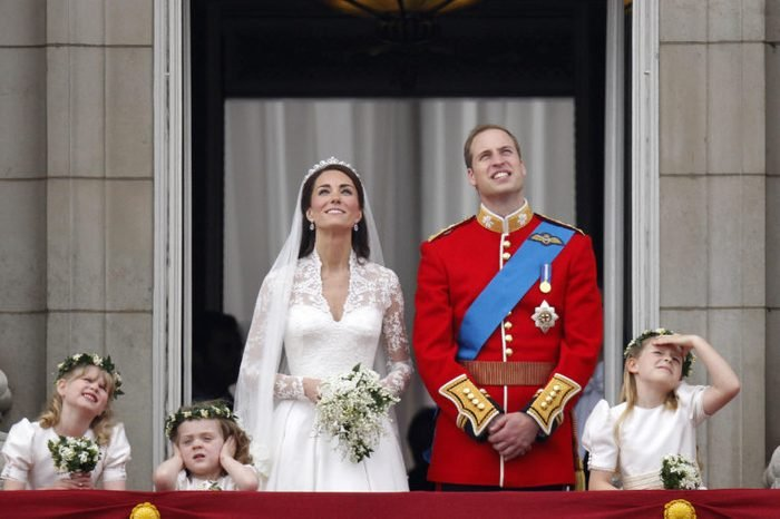The Royal Wedding Of Prince William & Catherine Middleton. View From Qvm Towards Buckingham Palace Showing William And His New Wife Catherine On The Balcony Watching The Fly-past The Royal Wedding Of Prince William Of Wales To Catherine Middleton (kate Middleton) On 29th April 2011. Now Duke And Duchess Of Cambridge.