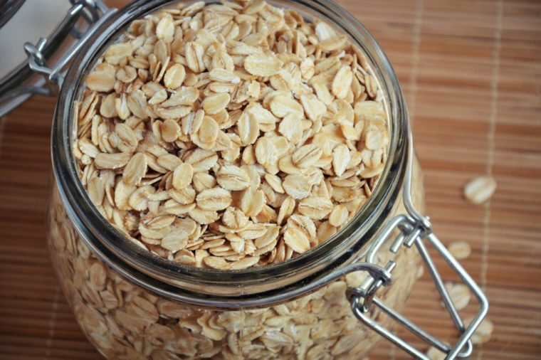 Rolled oats or oat flakes in jar. Healthy lifestyle concept. Top view, closeup.