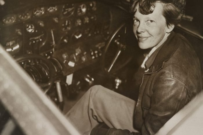 Amelia Earhart sitting in the cockpit of her Lockheed Electra airplane, ca. 1936. In July 1937 Earhart and the airplane were lost over the Pacific Ocean.