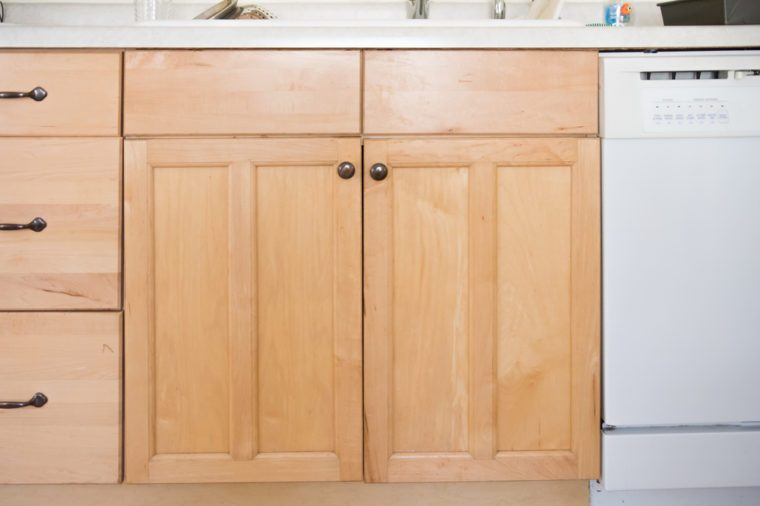 Front view of light wood kitchen cabinet