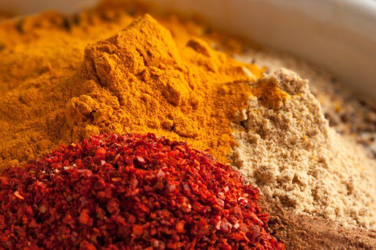 Colorful heap of spices. Aromatic landscape with seasoning. Paprika, turmeric, imbir, nutmeg