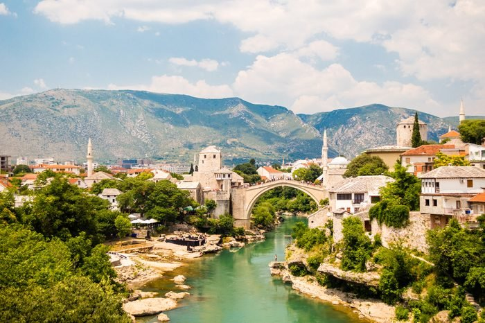 Beautiful view on Mostar city with old bridge, mosque and ancient buildings on Neretva river in Bosnia and Herzegovina