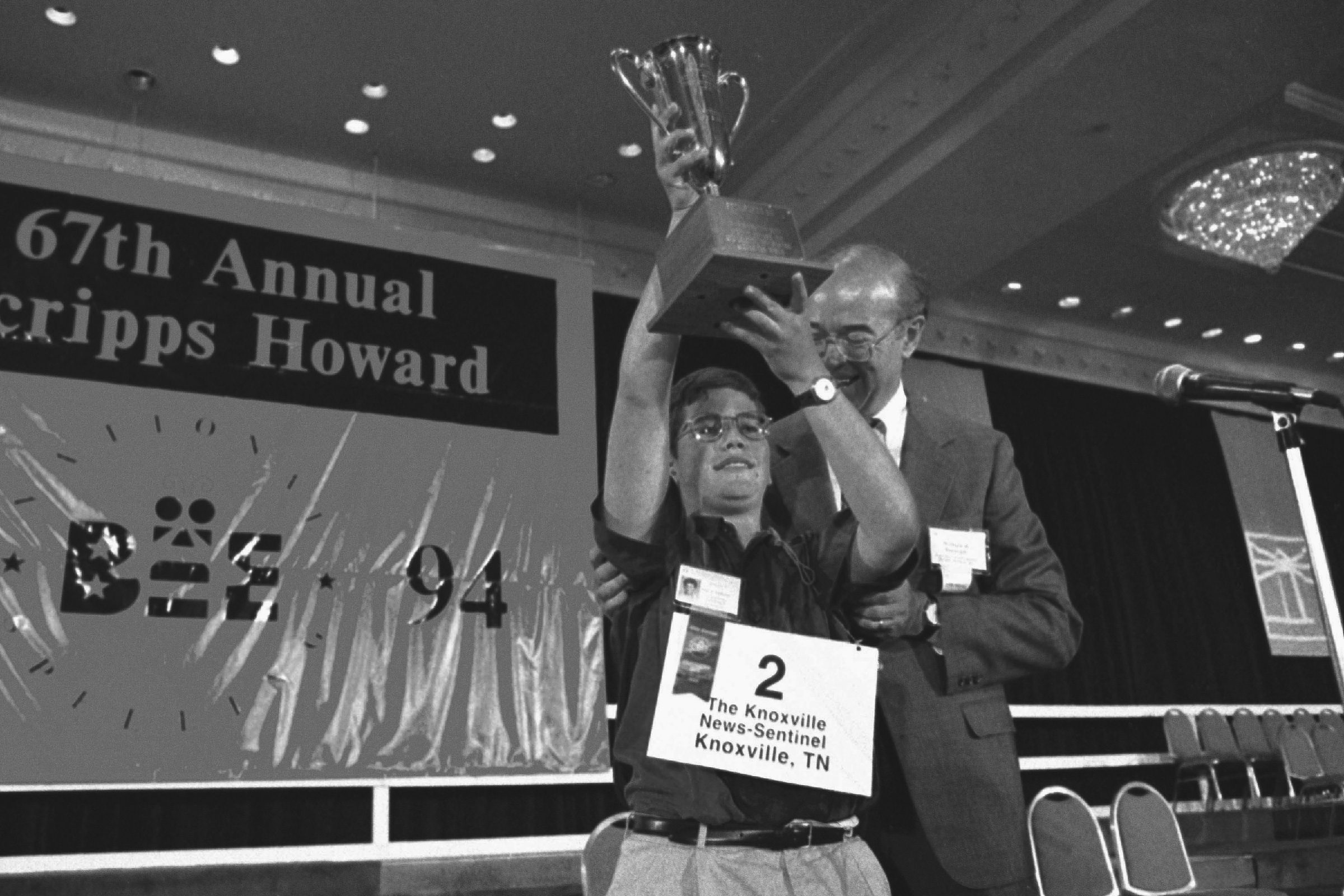 Ned G. Andrews, William Burleigh Ned G. Andrews, 13, a seventh-grader from Knoxville, Tenn., is congratulated by William Burleigh, chief operating officer of Scripps Howard Inc., after winning the National Spelling Bee in Washington, D.C